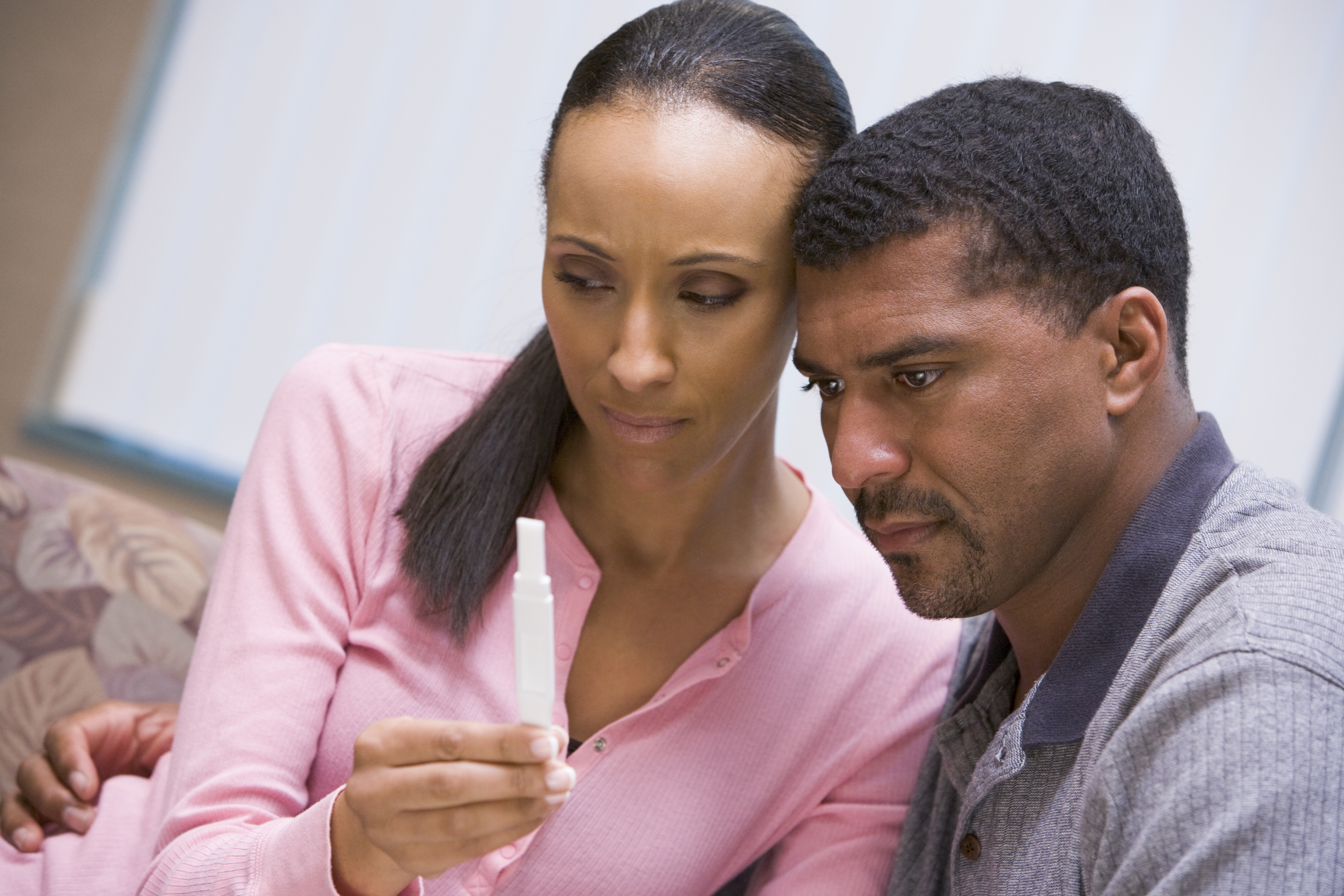 Couple looking at home pregnancy test